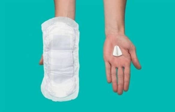 Picture of two hands one holding an incontinence pad one holding finess device