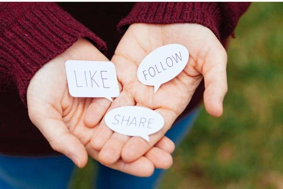 Hands Holding bubble words like, follow, and share