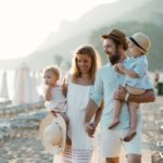 Family of 4 with young children at beach