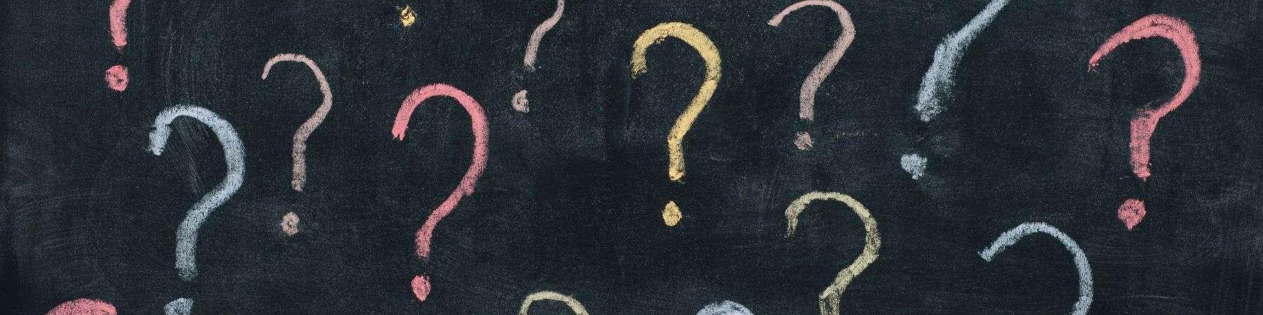 question marks on a chalkboard